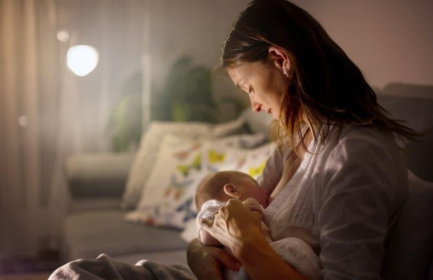 Woman breastfeeding at home