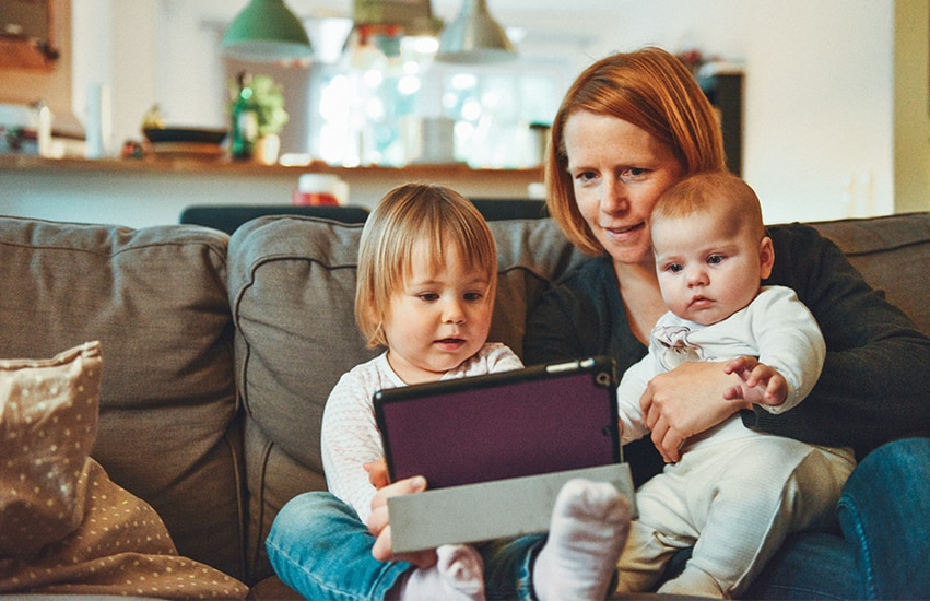 Woman with children on ipad