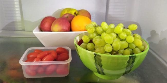 Fruit and cherry tomatoes ready to eat from the fridge