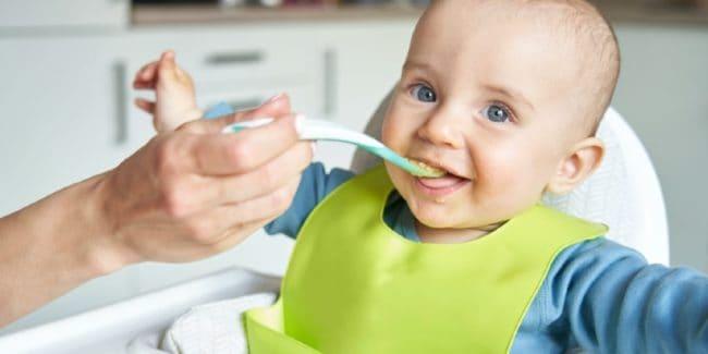 Happy baby eating