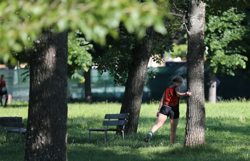 lady stretching in park