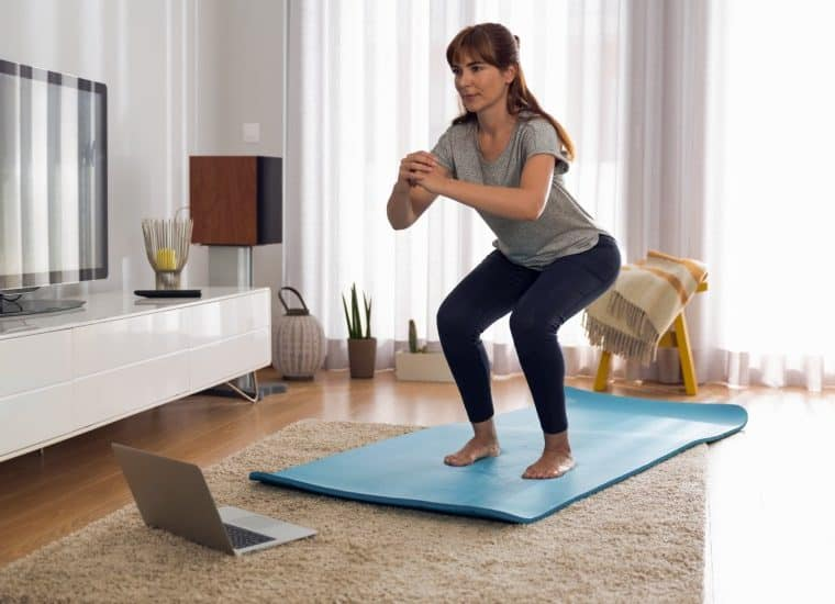 woman exercising in lounge room