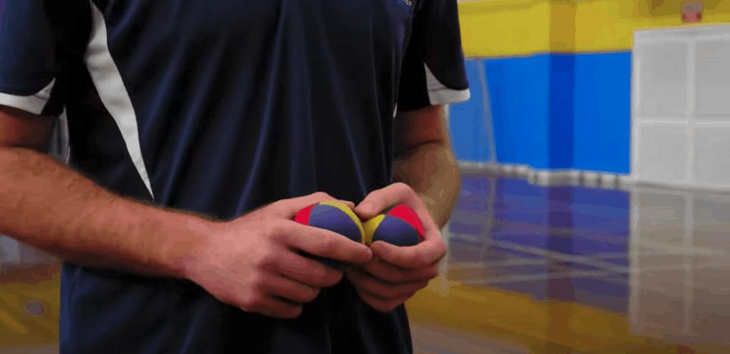 Instructor holding juggling balls