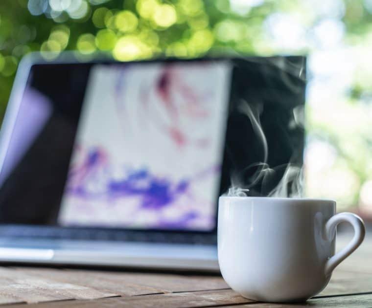 Laptop and mug on a table